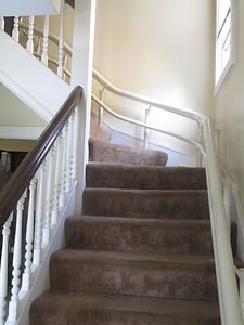 Access Lift installs and services curved stairway chairlifts.