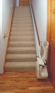 """Pinnacle chair lift folds to take just 11"""" of staircase width."""