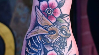 Noe traditional bee on a hand by Bobby Ellis Victory Tattoo Daytona