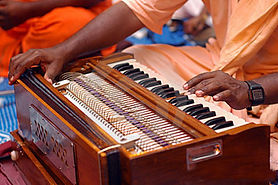 krishna-devotee-playing-harmonium-643870