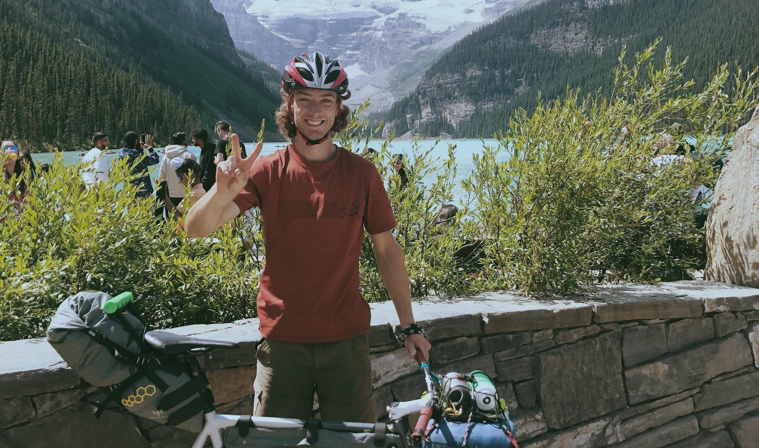 Rider happy smiling with fixie bike next to lake