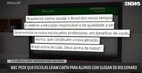 Carta com slogan da campanha de Bolsonaro e alunos sendo filmados ao cantar o hino nacional.