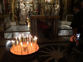 Fr. Mark venerates the place where the cross stood on Mount Calvary in the Church of the Holy Sepulchre.