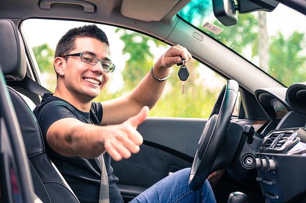 happy man in his car.jpg