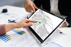 People Using Cadastral Survey Map On Tab
