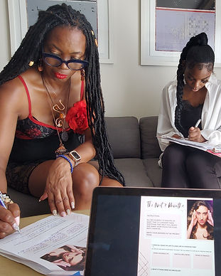 Clients of The Modelpreneur Bootcamp taking notes as Cole Woods empowers them with branding tips.