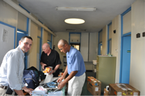 Dr. Guillem Lomax (left), Dr. Scott Powell (center) and Dr. Richard Gayle are seen here organizing the donated arthroscopic equipment in preparation for surgery at Mater Hospital.
