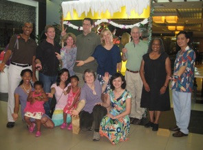Dr. Richard Gayle (left), Dr. Sean Rassman (second from left), Dr. Betsy Watson (third from left), Dr. Eda Van Dyk (fifth from left), Dr. Ngyuen (far right), Dr. Francie Sharpe (bottom row, second from right) and colleagues celebrating their last day in Saigon with Operation Arthroscopy.