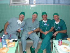 Volunteer surgeons Drew Miller, MD (left), William Stetson, MD (2nd from left), Gene Muse, MD (3rd from left) and Scott Fisher, MD (far right) after a long day of surgery in Ciego de Avila, the center of arthroscopic surgery in Cuba and site of the first center established by Operation Arthroscopy.