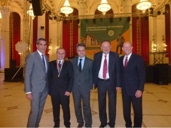 Dr. Guido Marra (left) and Dr. William Stetson (far right) are seen here in Bucharest in 2015 with the Romanian Orthopaedic Society Presidential line.