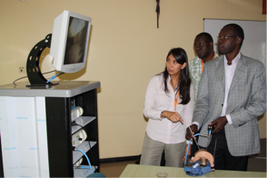 Dr.Zenia Cortes (left) is teaching arthroscopic surgical skills on a model to the doctors of Mater Hospital in Nairobi.