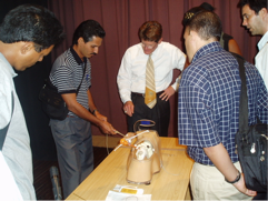 Volunteer surgeon Gene Muse, MD from Oklahoma City instructs his Cuban colleagues in 2004 on shoulder arthroscopy using a shoulder model which helps surgeons develop the skills needed to perform shoulder arthroscopy before they go into the operating room.
