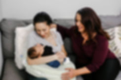 lactation consultant with new mom newborn breastfeeding