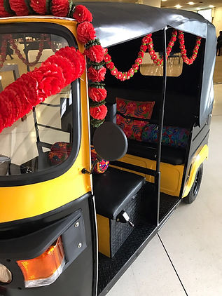Authentic Tuk Tuk/Rickshaw which has some great decor on it. It includes bright garlands and india style cushions.