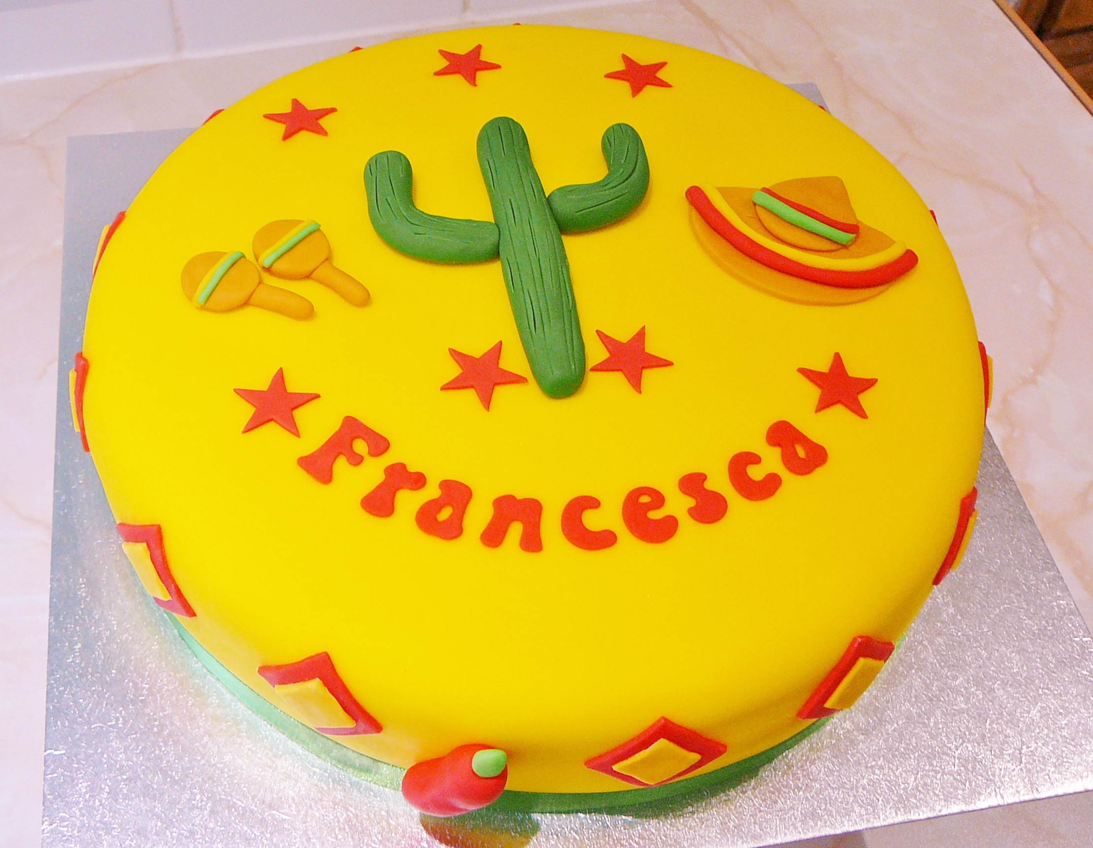 Mexican yellow fondant cake