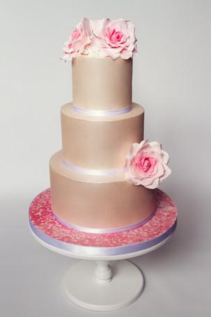 Satin sheen wedding cake with pink roses