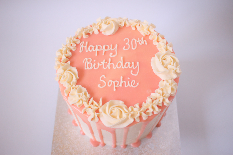 White chocolate ganache pink drip cake
