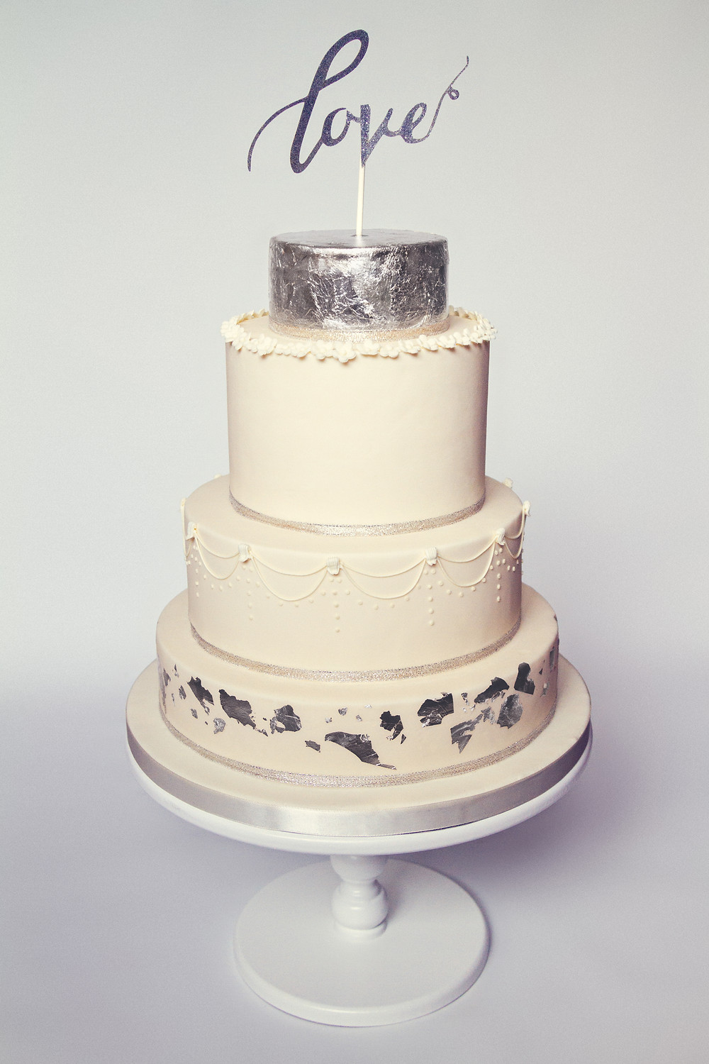 Metallic wedding cake with silver leaf