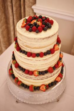 Semi-naked wedding cake with fresh fruit
