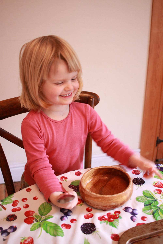 Child ready to make homemade gluten-free pizzas