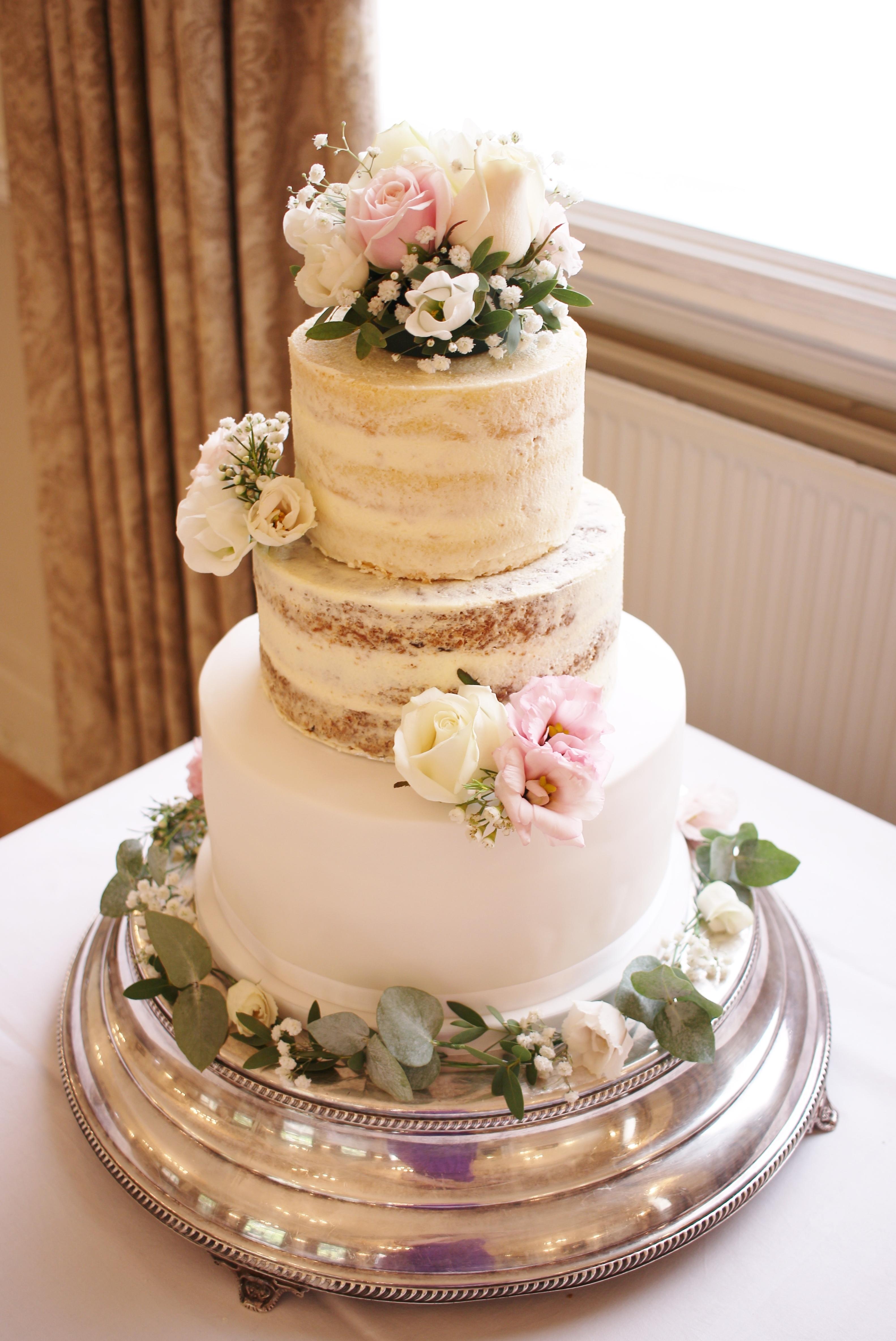 Semi-naked wedding cake with fondant