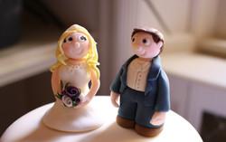 Bride & groom in blue suit toppers