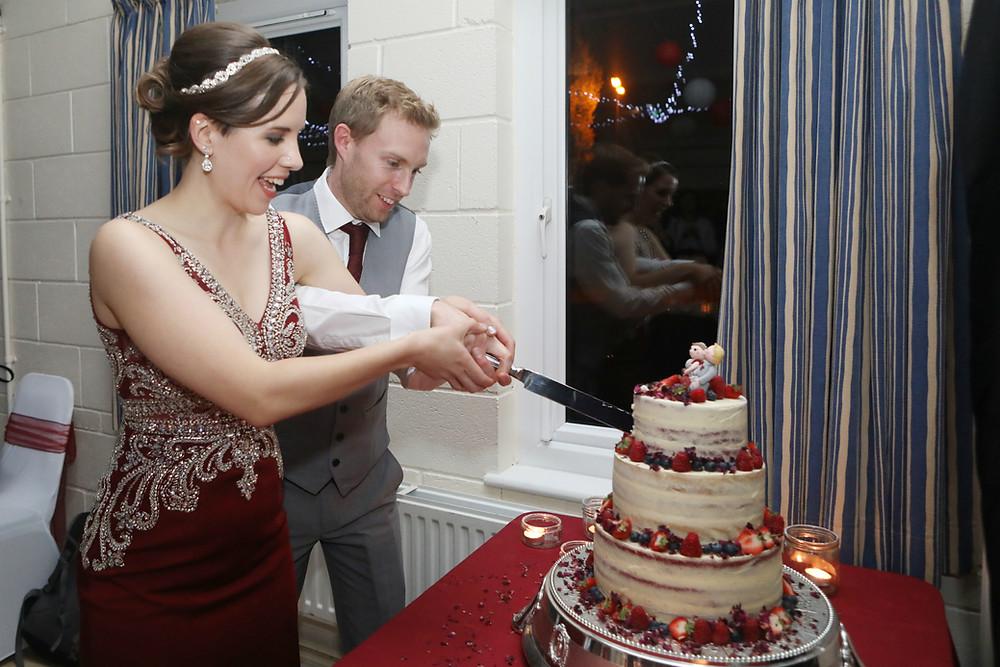 Bride & groom cutting their gluten-free wedding cake