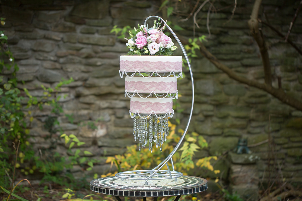 Pink lace & pearl chandelier cake