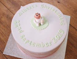 Christening cake with baby topper