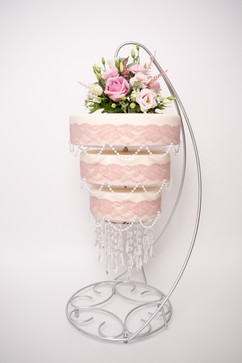 Chandelier wedding cake with pink flowers