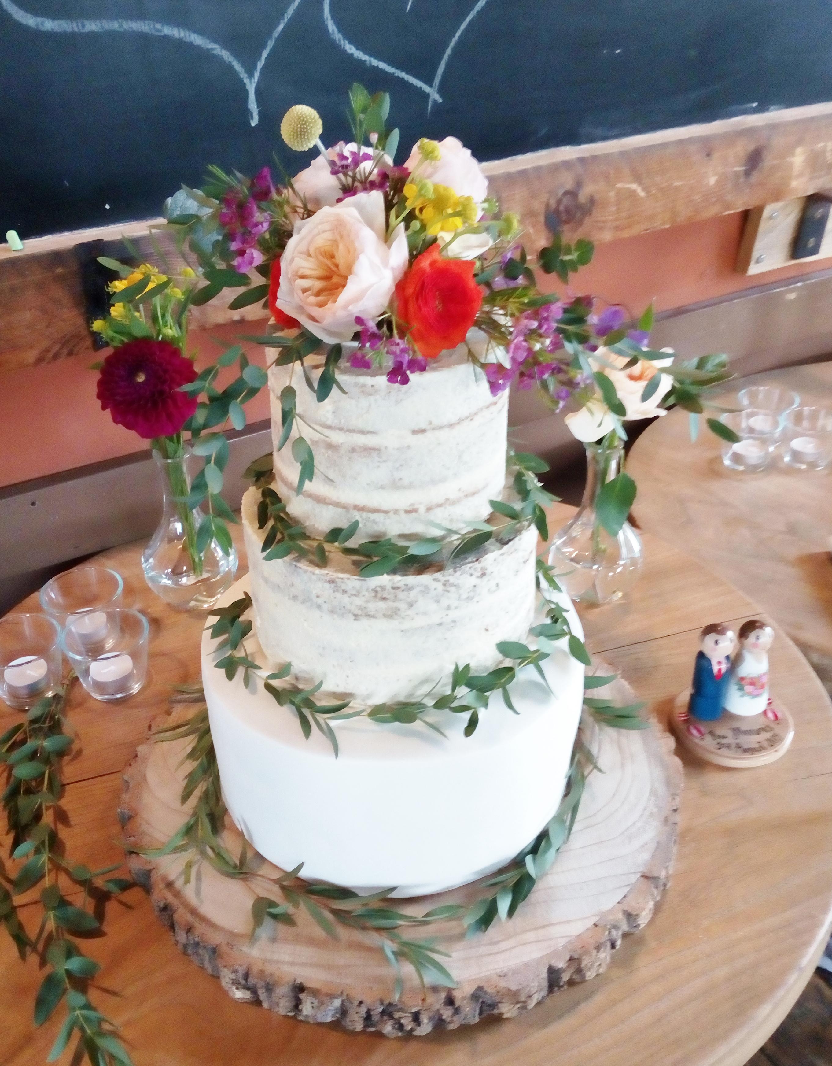 Semi-naked wedding cake with fondant base