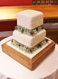2 tier square ivory wedding cake