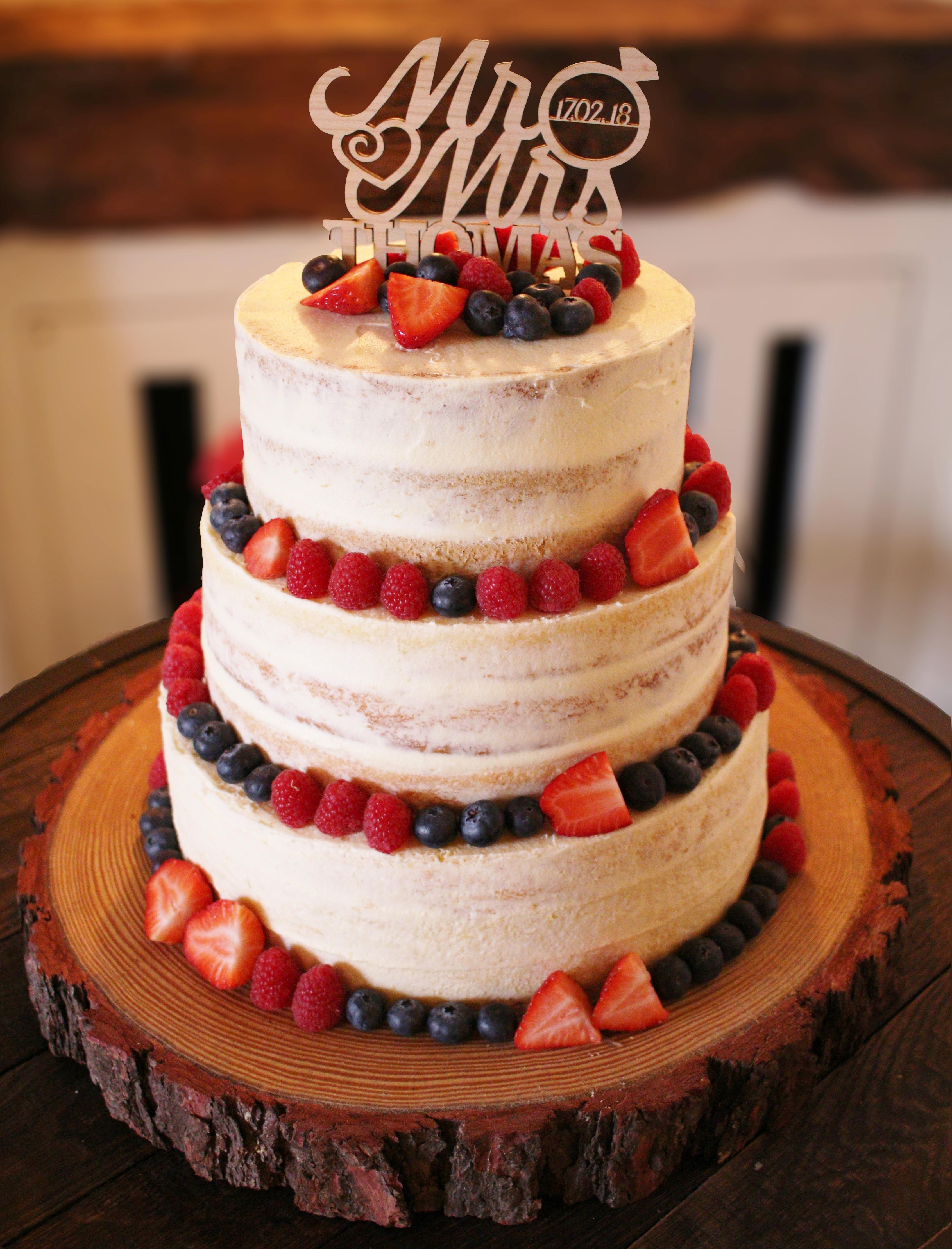 Semi-naked dairy-free wedding cake with fresh fruit