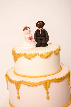 Bride & Groom toppers on gold wedding cake
