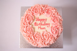 2D pink roses in buttercream