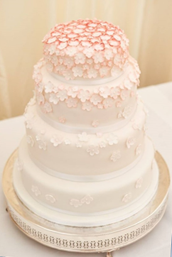 Ombre pink flowers wedding cake