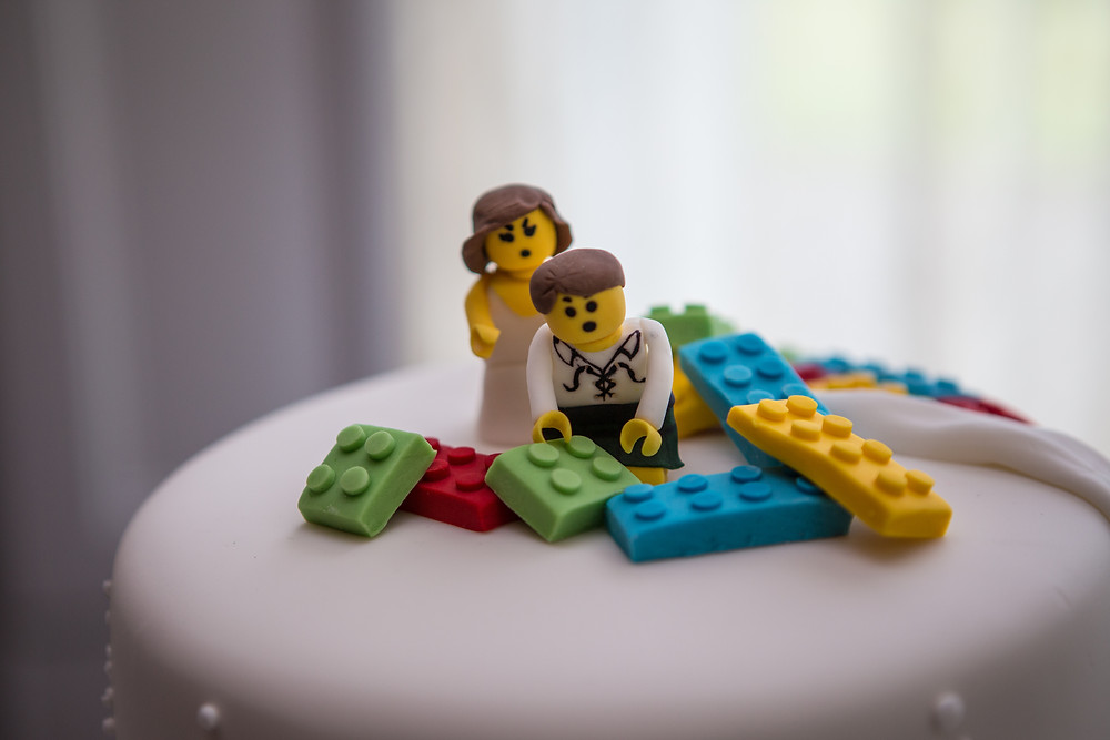 Lego toppers on a wedding cake