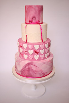 4 tier pink marble hearts wedding cake