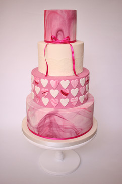Pink marble hearts wedding cake