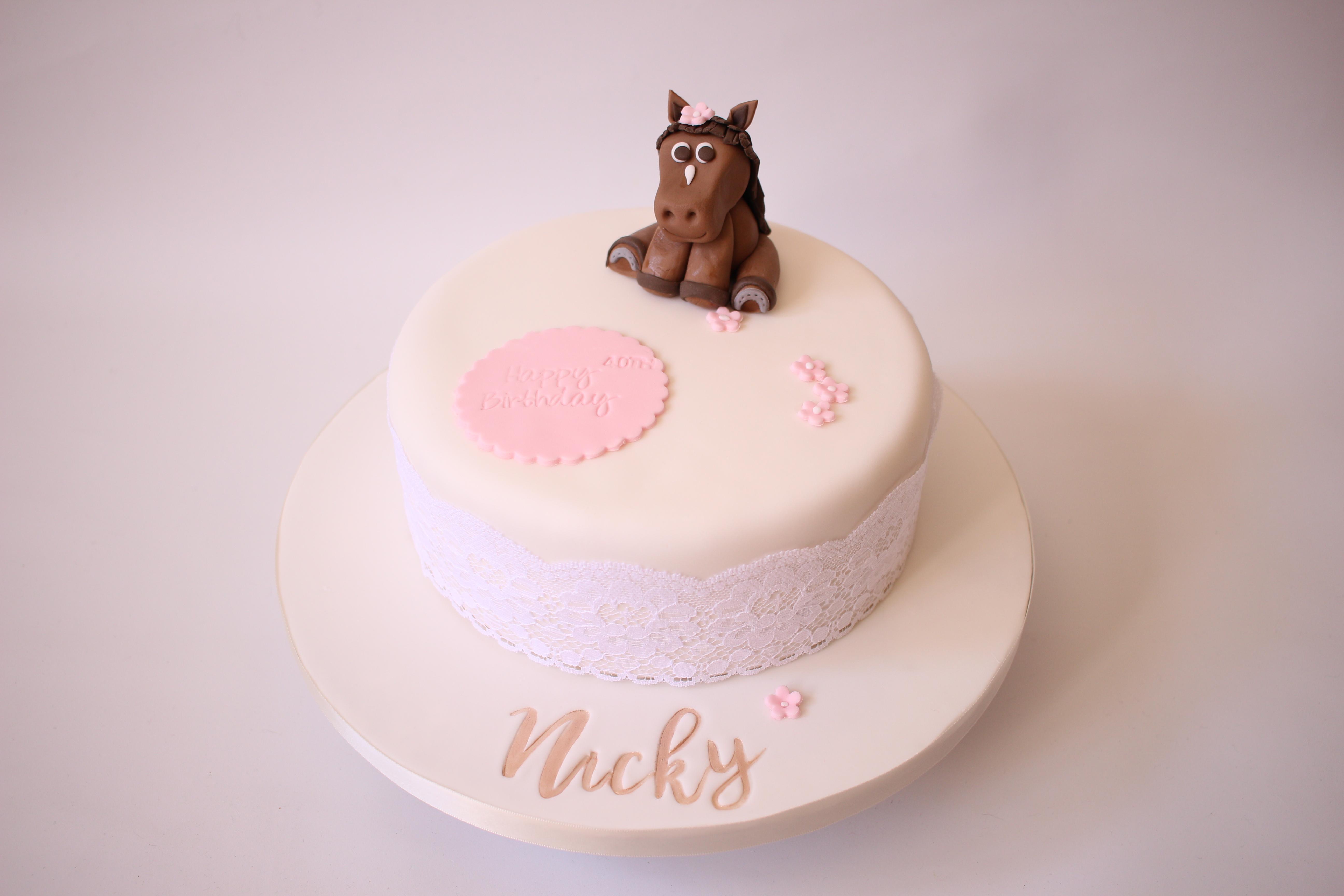 Fondant bay horse on cake