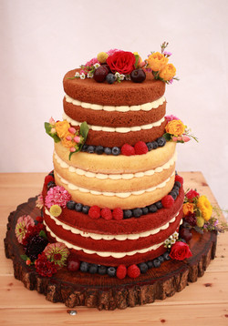 3 tier naked wedding cake with different flavours