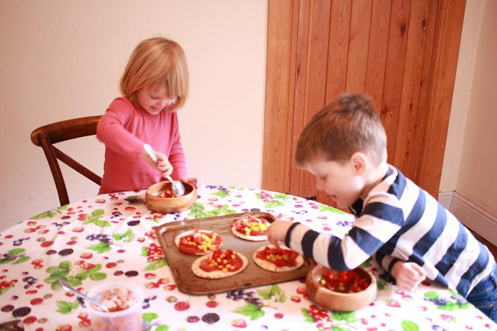 Children making gluten-free pizzas