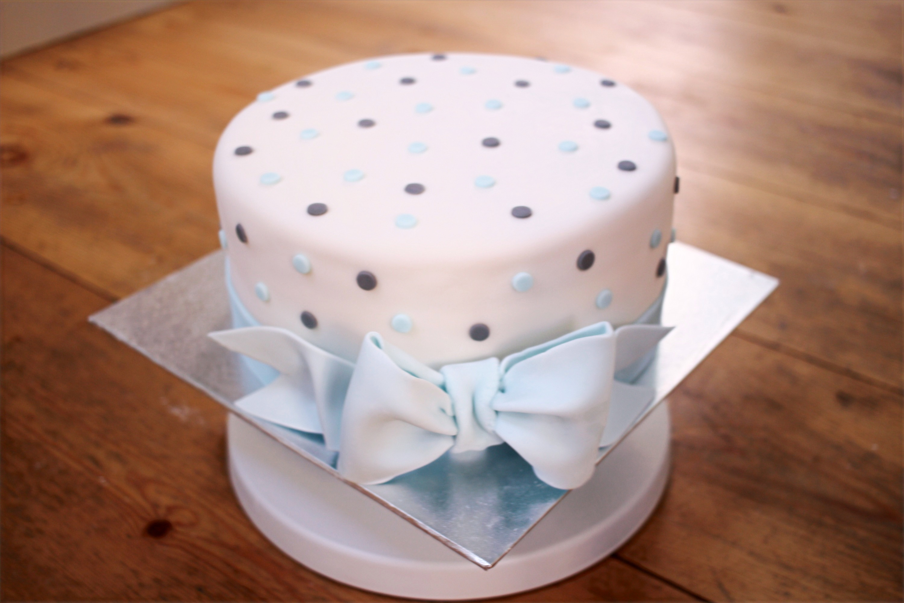 Blue bow on polka dot cake