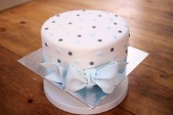 Blue bow on polka dot cake