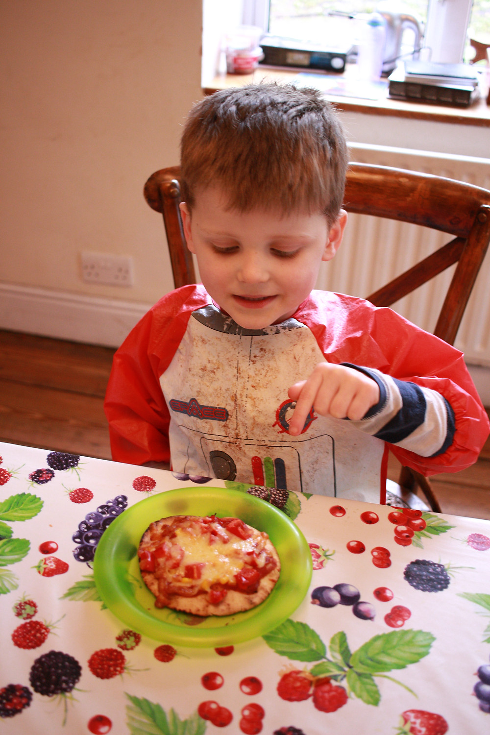 Child with homemade gluten-free pizza