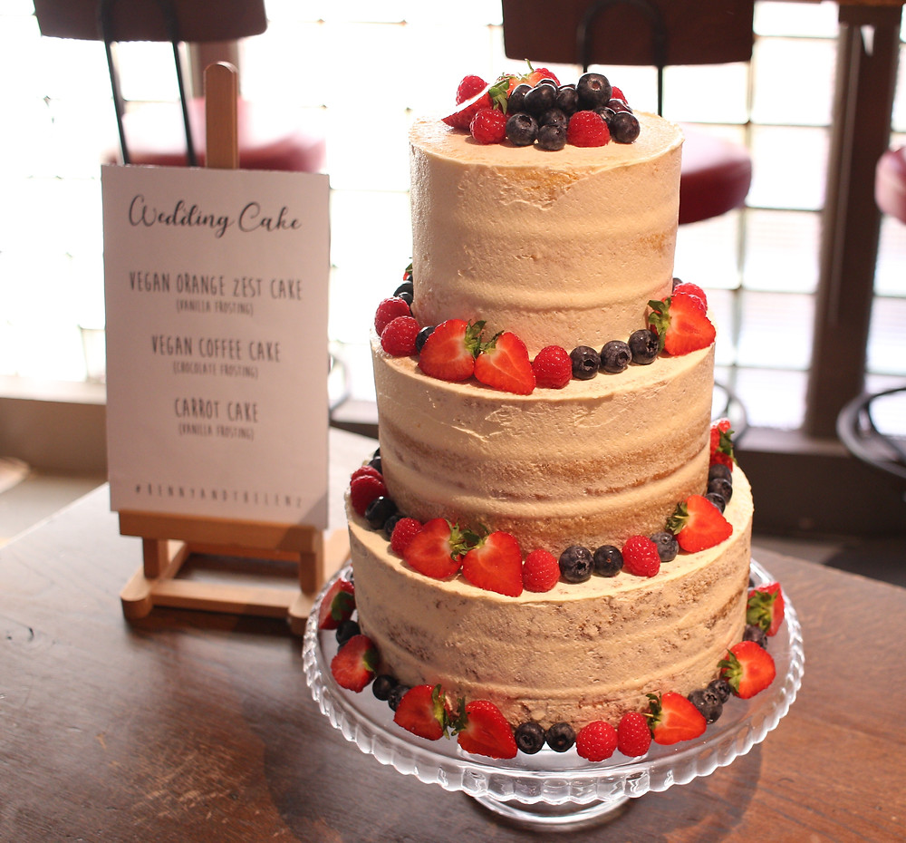 A semi-naked cake with its own easel!