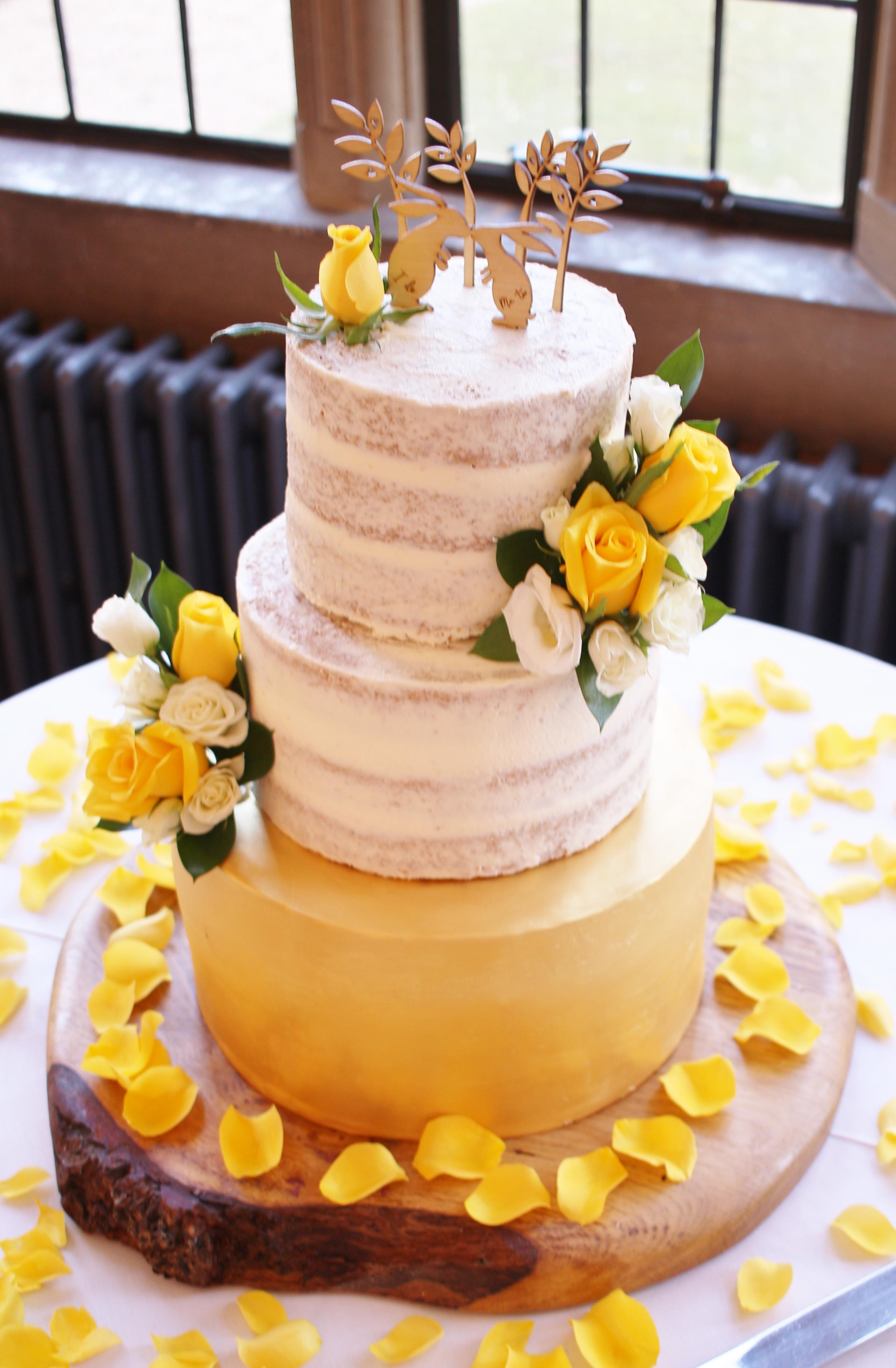 Gold tier semi-naked wedding cake