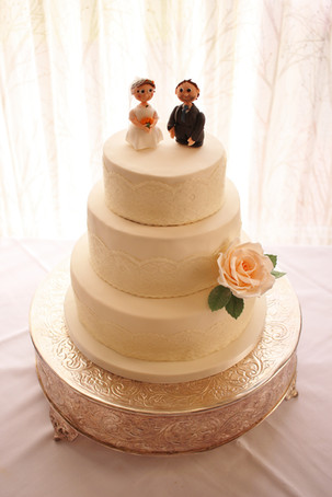 Ivory lace & peach rose wedding cake