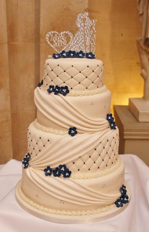 Draped ivory wedding cake