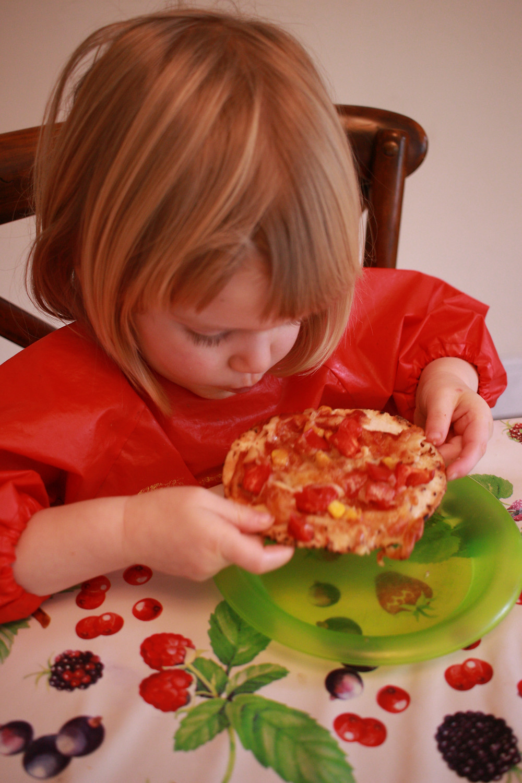 Child eating homemade gluten-free pizza